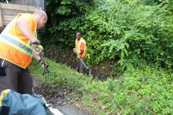 Clearing drainage ditch