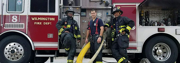 Too Cool 4 school firefighters in front of engine
