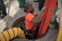 Crews perform hurricane repairs on Henry St