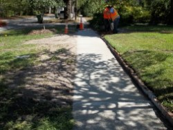 Crews perform hurricane repairs on sidewalks